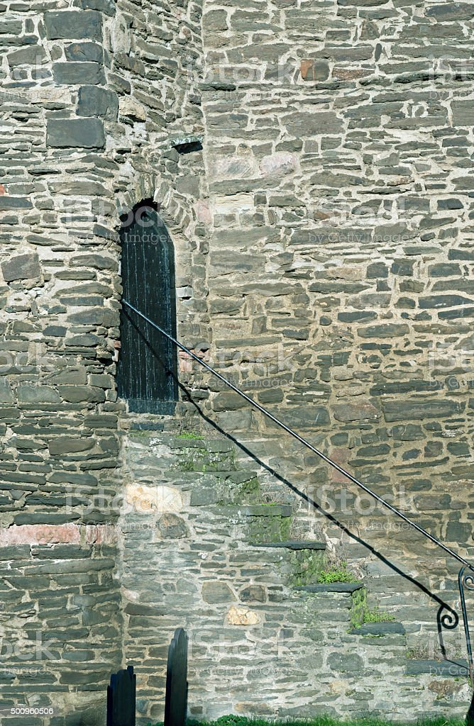 Stairs from churchyard to backdoor of church in Wales stock photo