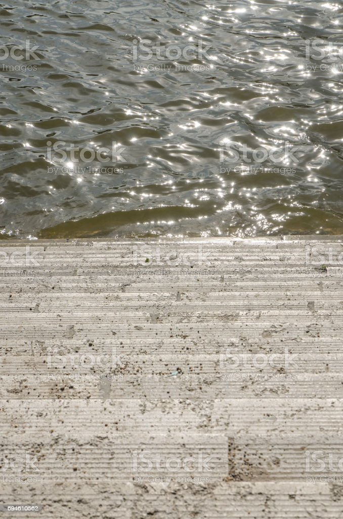 Stairs going down into Danube river in Budapest during summer day stock photo