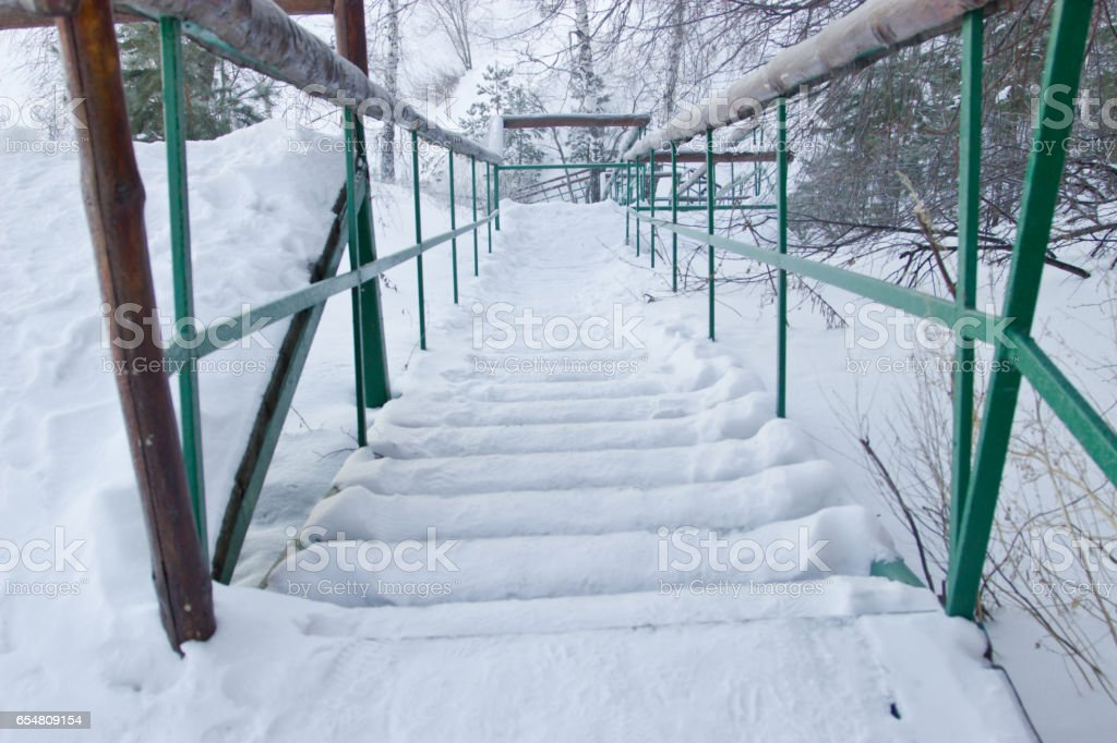 Stairs in the forest swept snow. stock photo