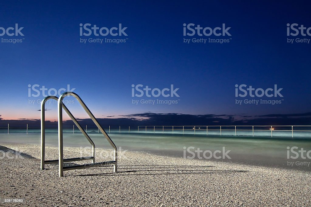 stairs into sand stock photo