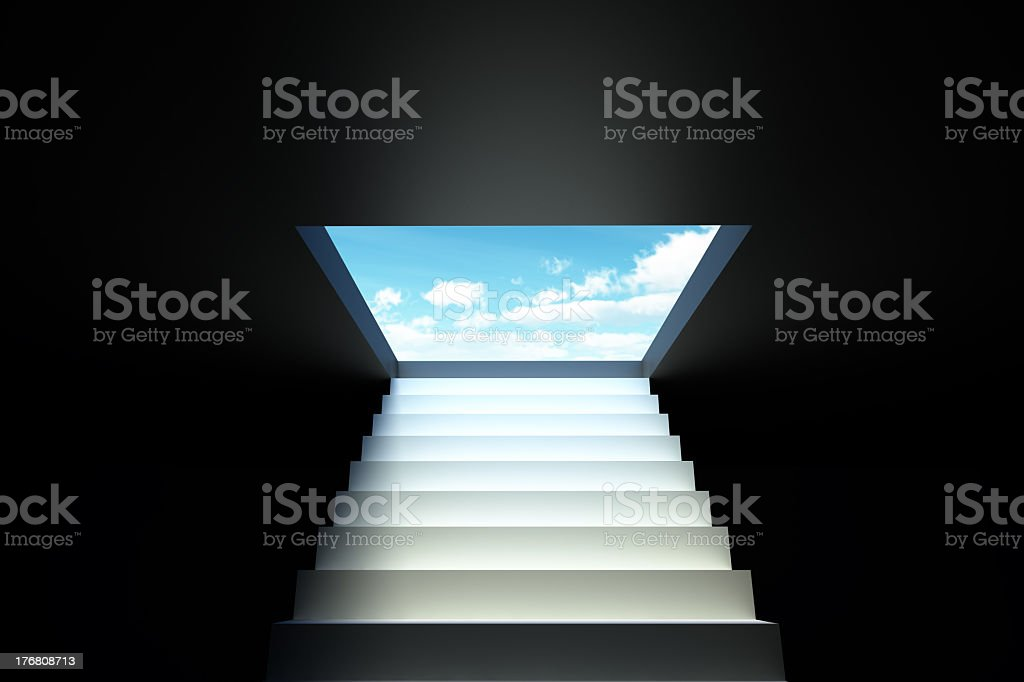 Stairs leading from the darkness to the blue sky stock photo