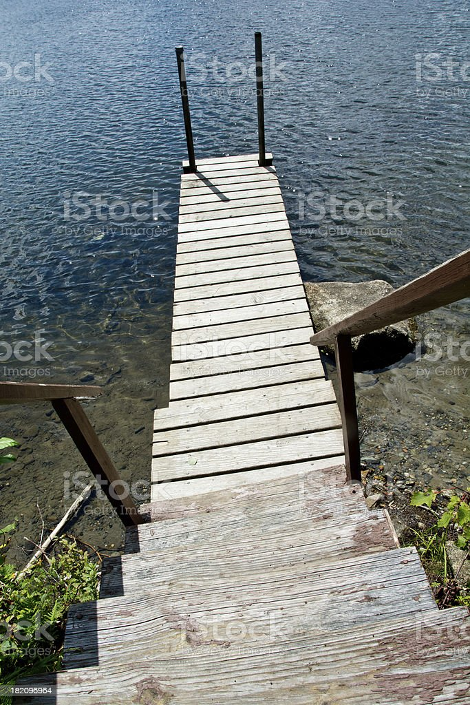 Stairs leading to a lakeside deck royalty-free stock photo