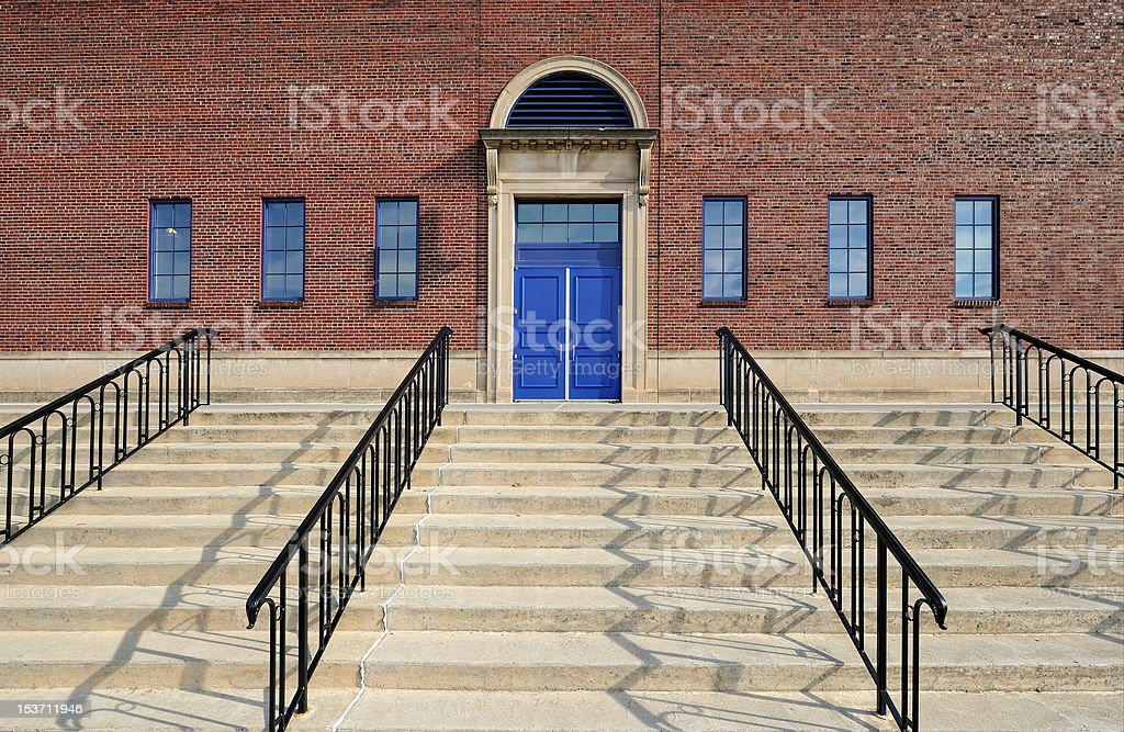Stairs to blue doors royalty-free stock photo