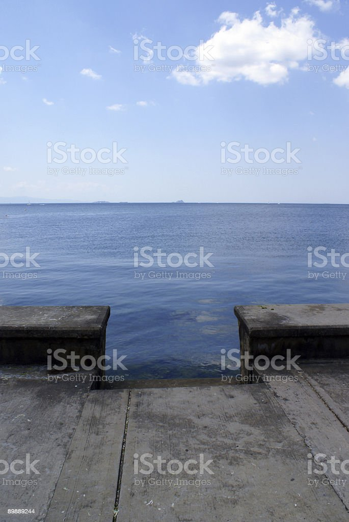 Stairs to Sea and Distant Island royalty-free stock photo