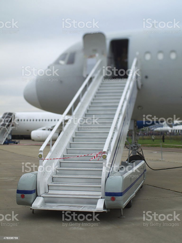 Stairs to the plane stock photo