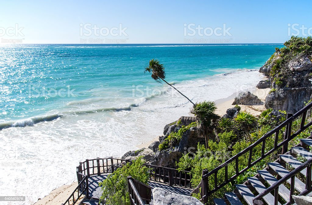 Stairs to white sand beach stock photo