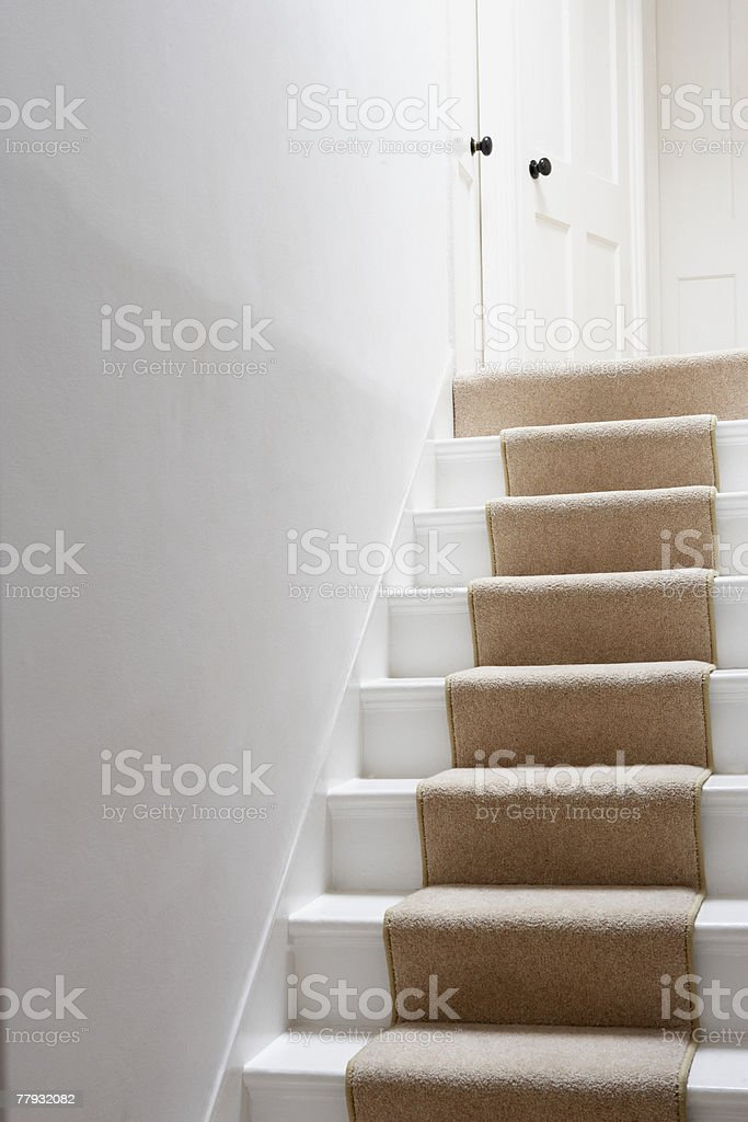 Stairs with beige runner stock photo