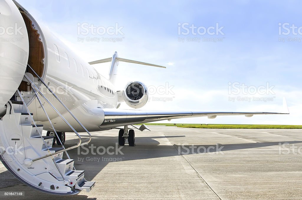 Stairs with jet engine on a private airplane - Bombardier stock photo