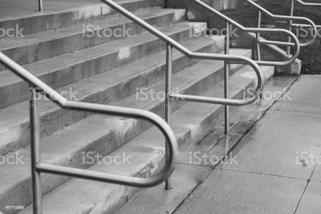 Stairs with metal railings black and white stock photo