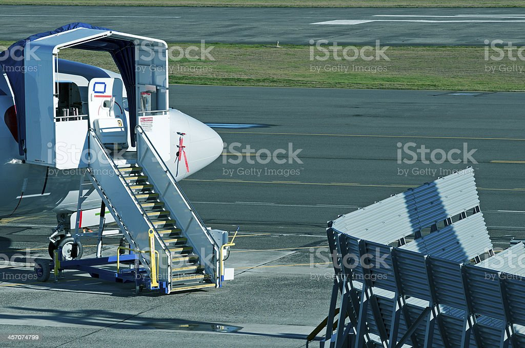 Stairway to airplane cockpit undergoing maintenance at airport stock photo