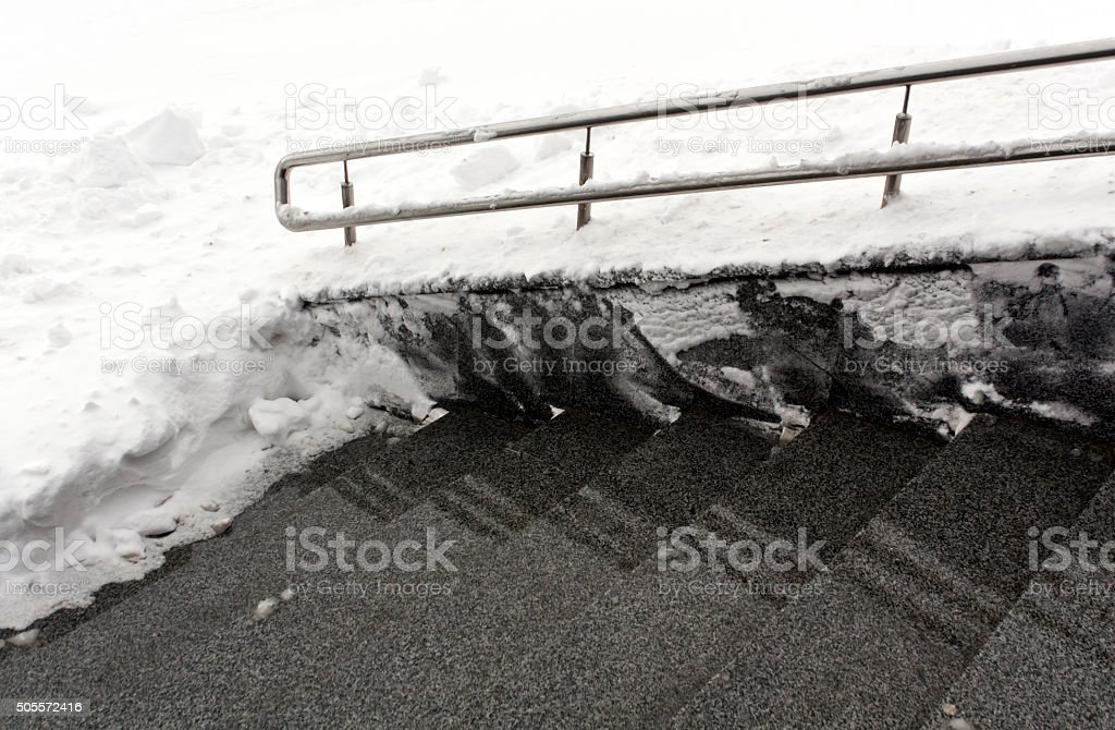 Stairway with handrail in snow. stock photo