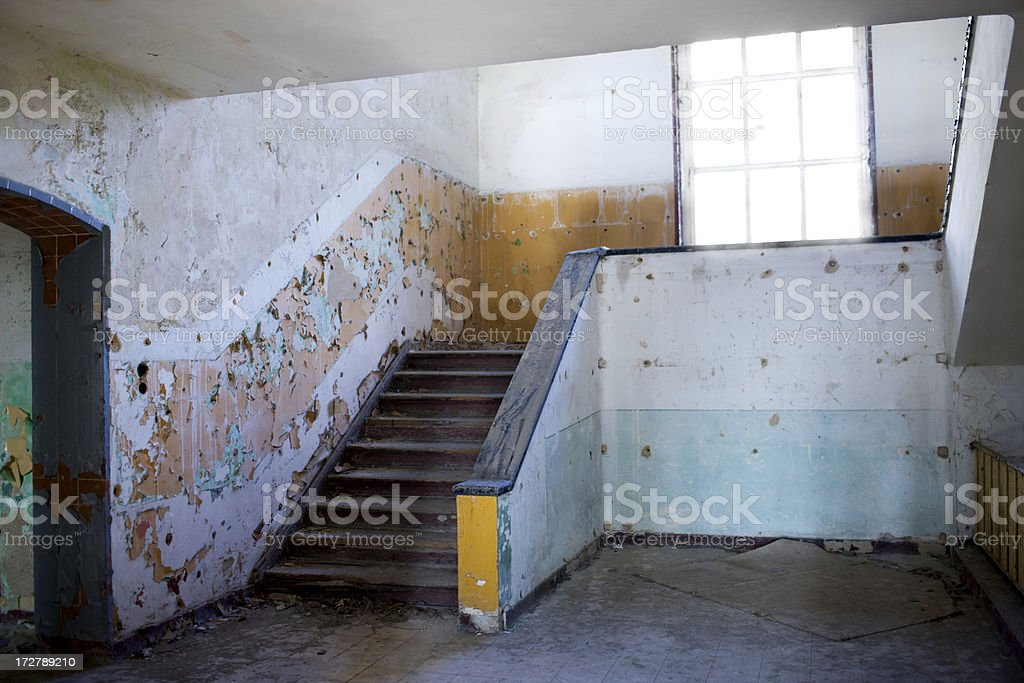 Stairwell in an abandoned building royalty-free stock photo