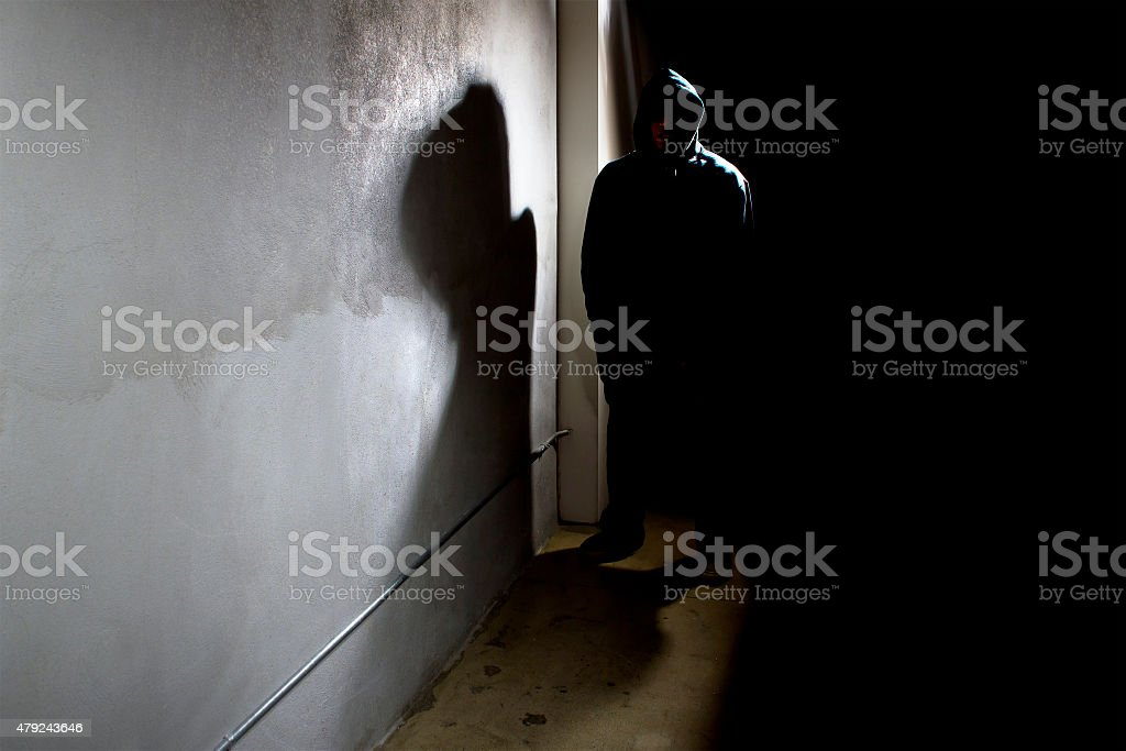 Stalker in a Dark Alley stock photo