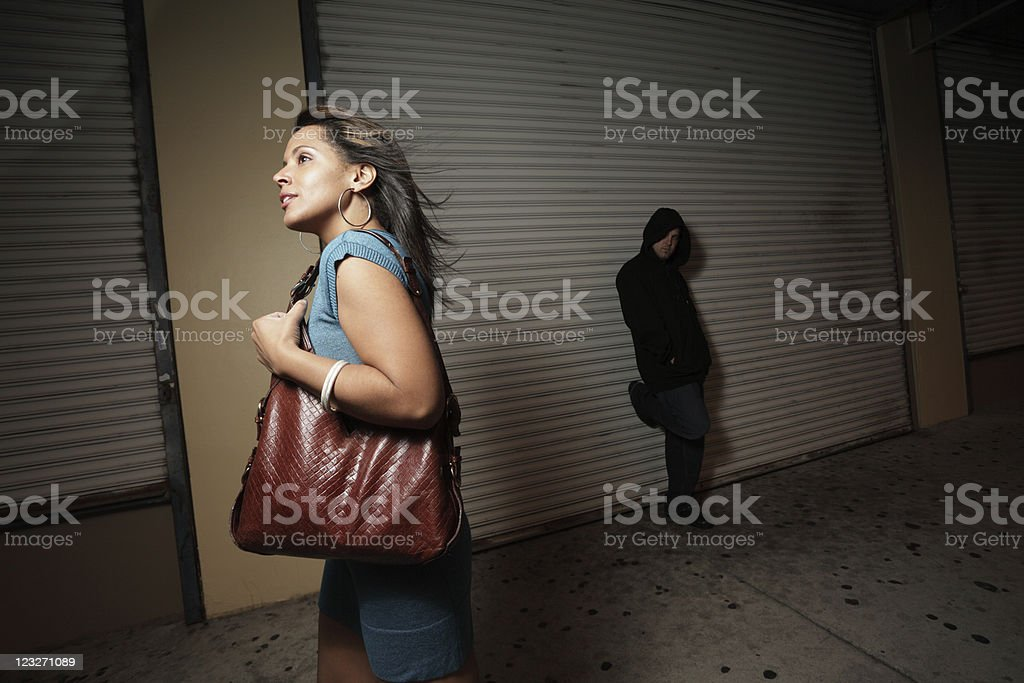 Stalker in the shadows stock photo