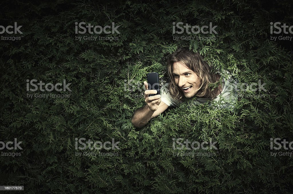 Stalker with smart phone stock photo