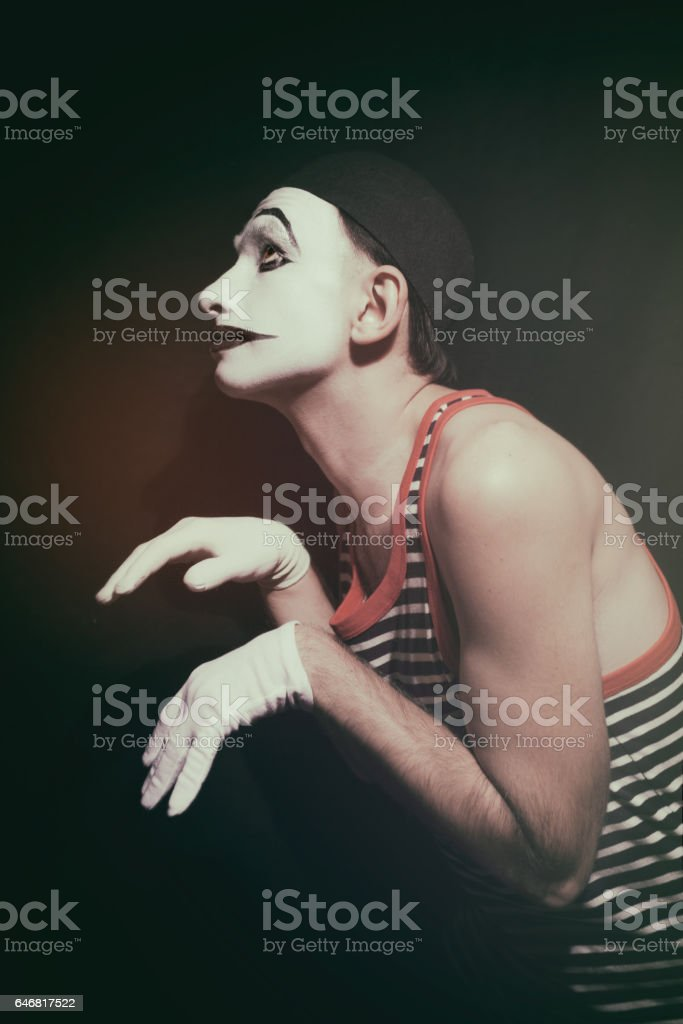 Stalking actor mime on a black background stock photo