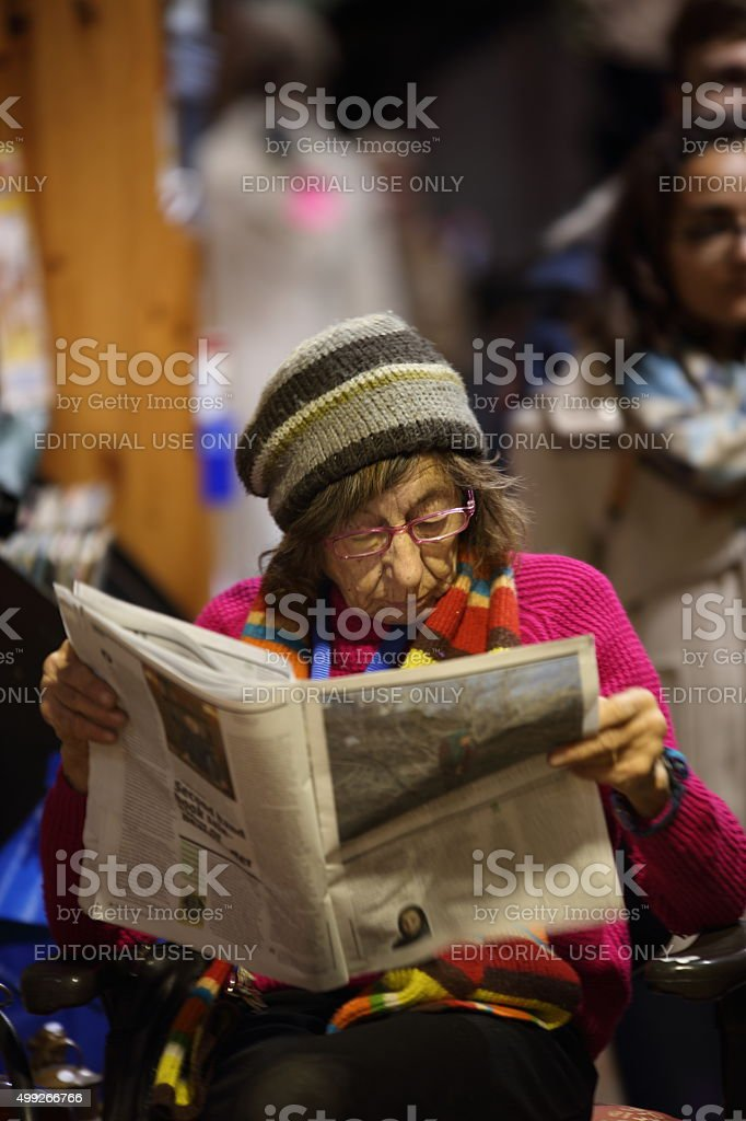 Stall holder reading paper stock photo