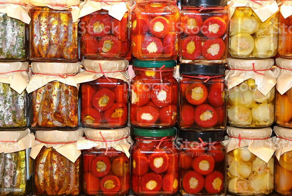stall southern Italy with pots of peppers and anchovies stock photo