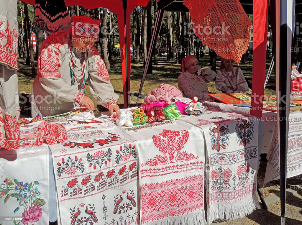 Stall with handicraft rushnyks and crocheted items stock photo