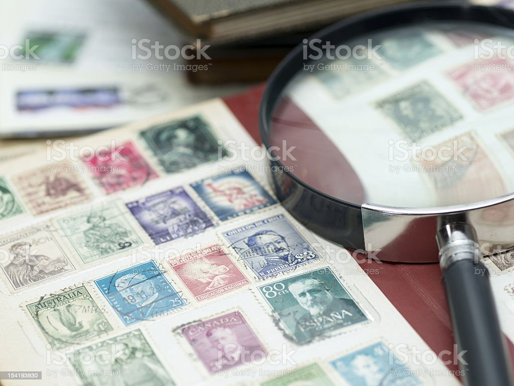 Stamp collection with magnifier glass (XXXLarge) stock photo