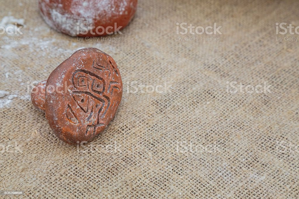 Stamp for bread with neolithic drawings stock photo