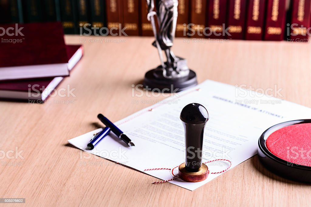Stamp of the notary on signed power of attorney. stock photo