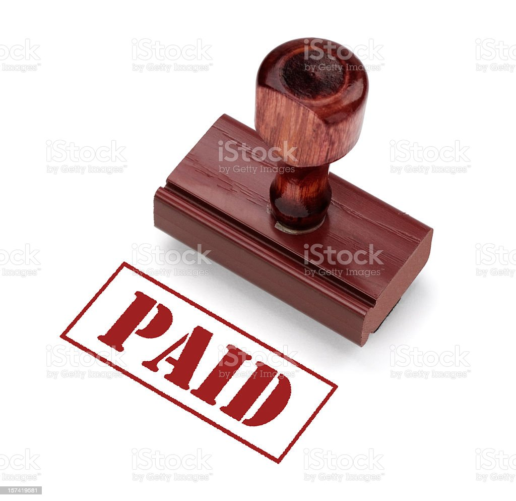 Stamp that says PAID and the stamper that made it royalty-free stock photo
