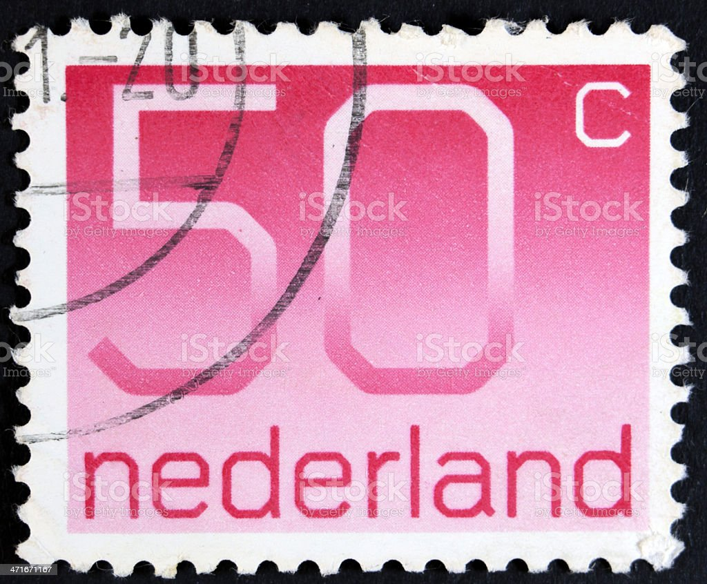 Stamp with a value of Fifty cents royalty-free stock photo
