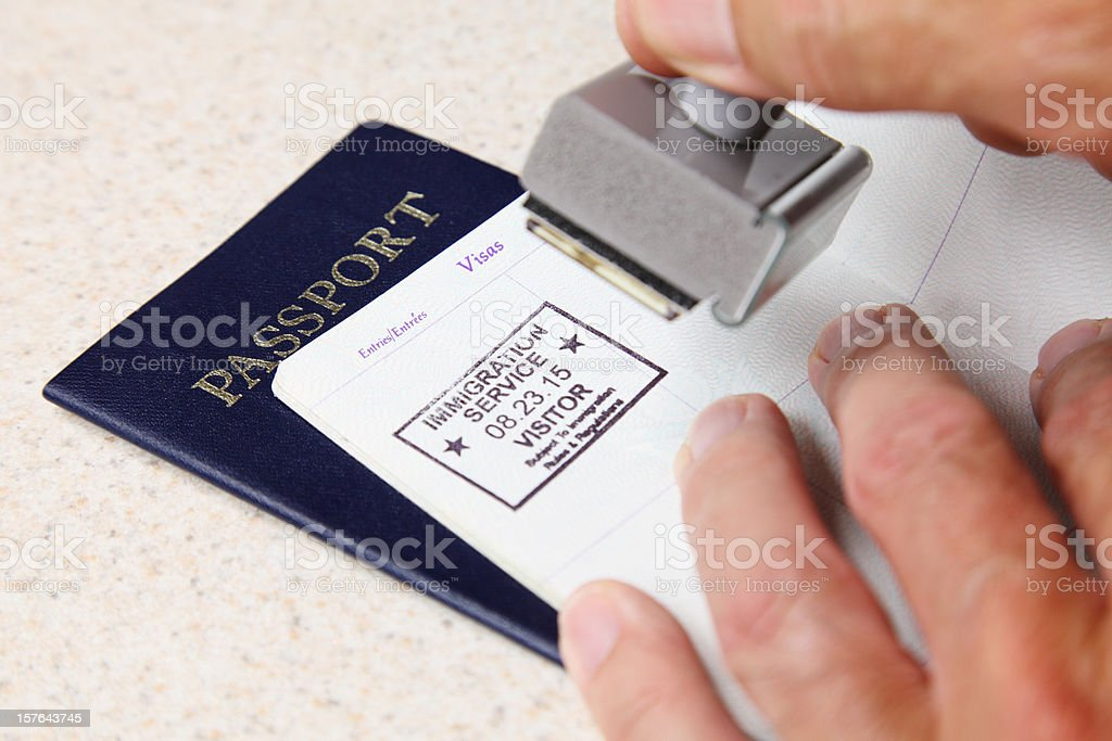 Stamping Passports stock photo