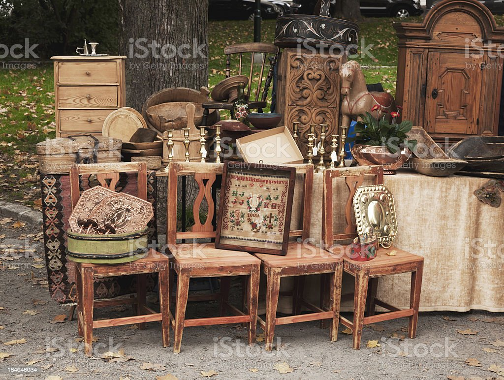 Stand at an outdoor market with antique wooden furniture. royalty-free stock photo