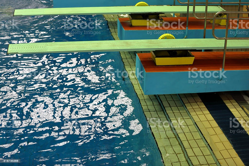 Stand for a jump in the swimming pool stock photo