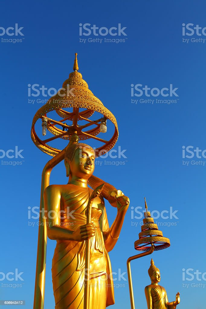 Stand golden budha,with blue sky stock photo