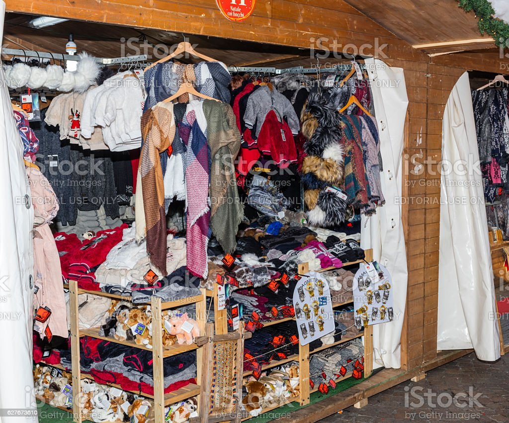 Stand of handmade clothing exposed during a Christmas market stock photo