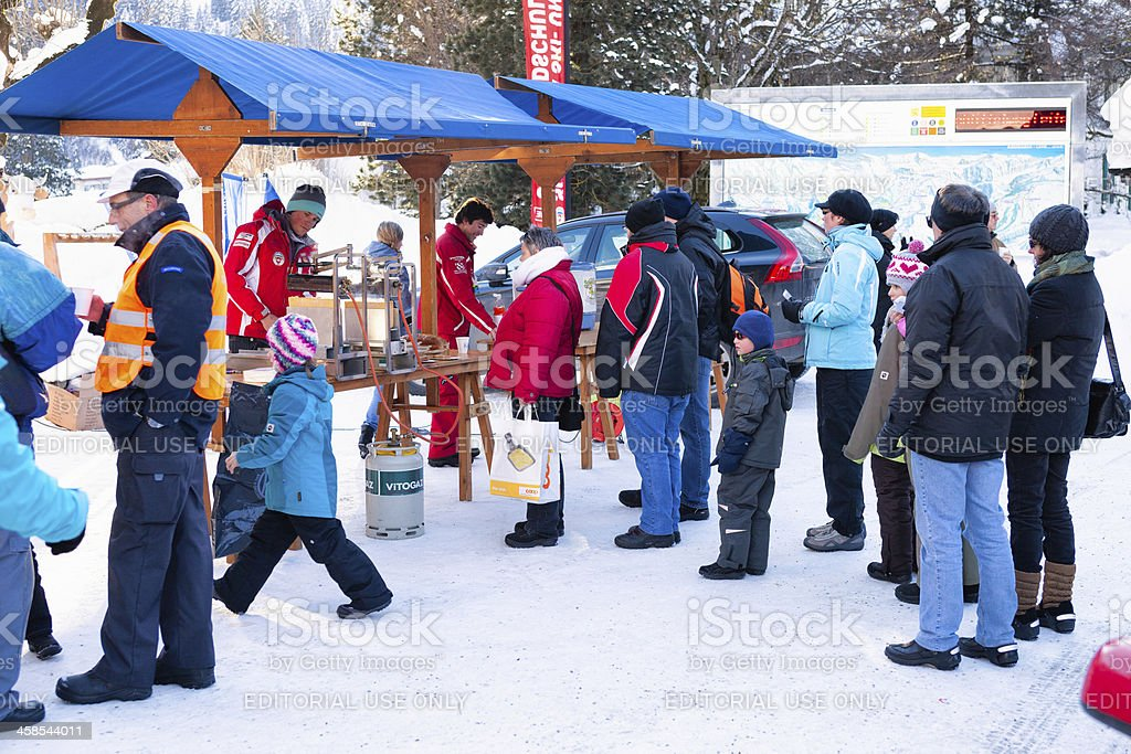 Stand offering hot wine and raclette to guests royalty-free stock photo