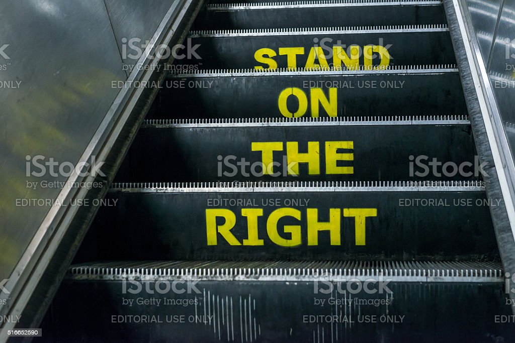 Stand on the right notice on an escalator stock photo
