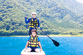 Stand up paddle boarding family