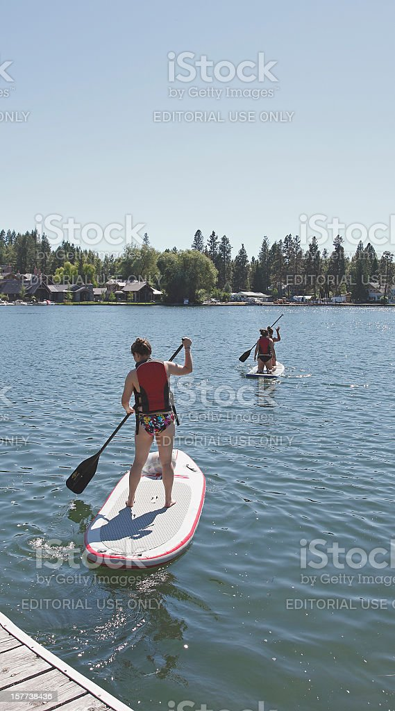 Stand Up Paddle Boarding On Gentle Water stock photo