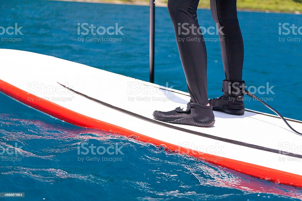 Stand up paddle boarding people stock photo