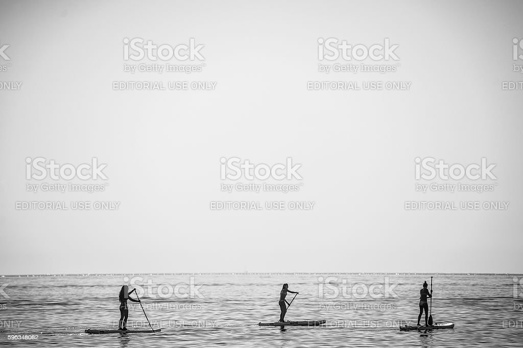 stand up paddle group on stock photo