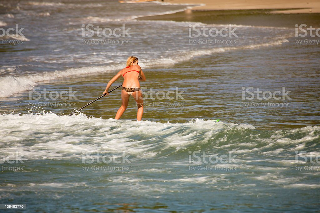 Stand Up Paddle Surfer Girl stock photo