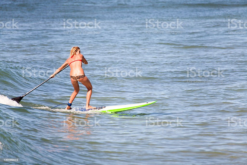 Stand Up Paddle Surfer Girl royalty-free stock photo