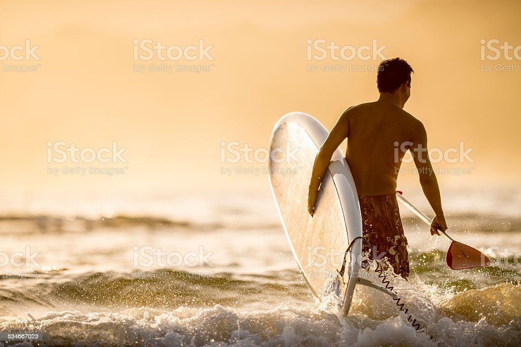 Stand up paddleboarding in the sea stock photo