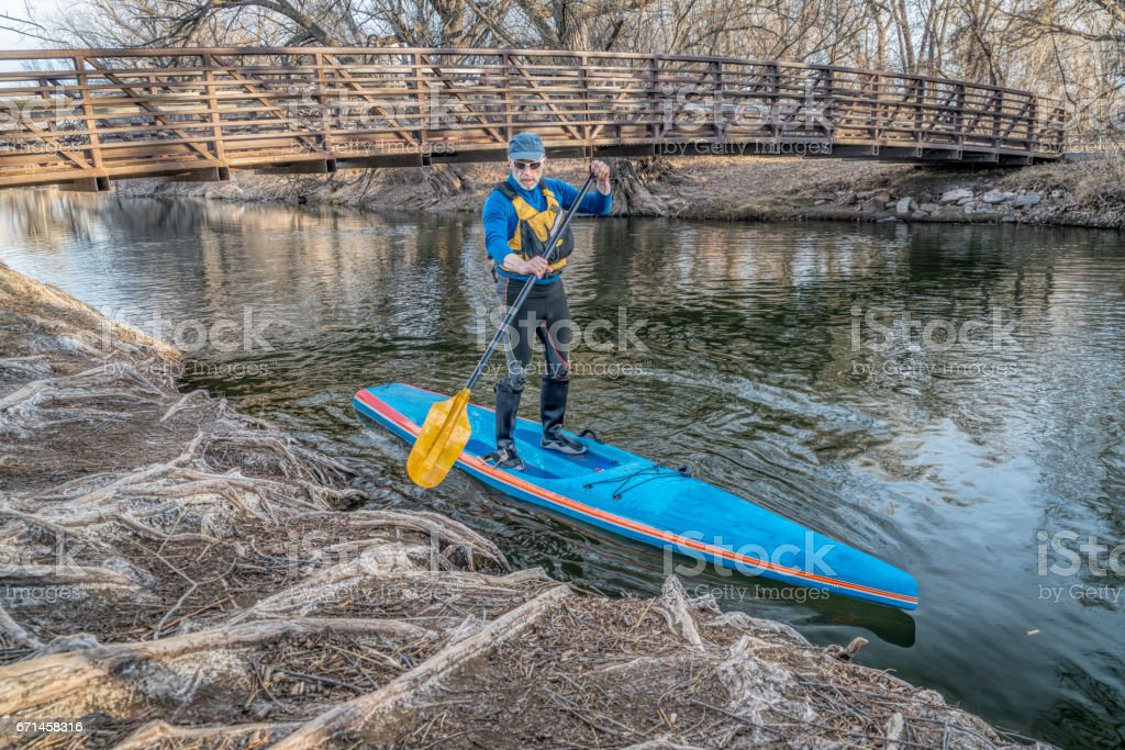 Stand up paddling on the Poudre RIver in Colorado stock photo