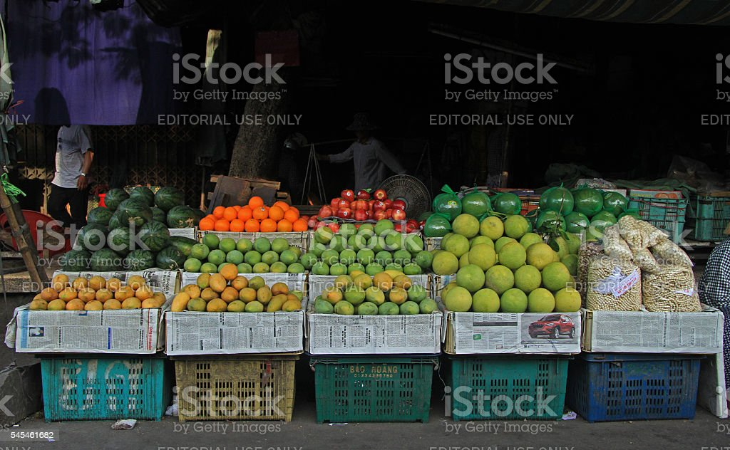 stand with fruits on street market in Hue stock photo