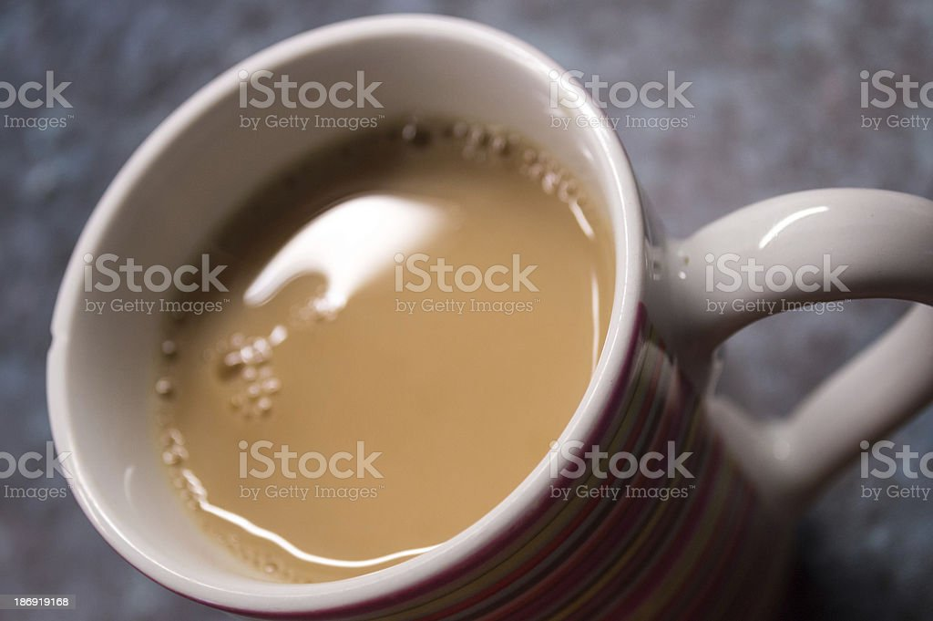 Standard Cup of Brewed Black Tea with Milk royalty-free stock photo