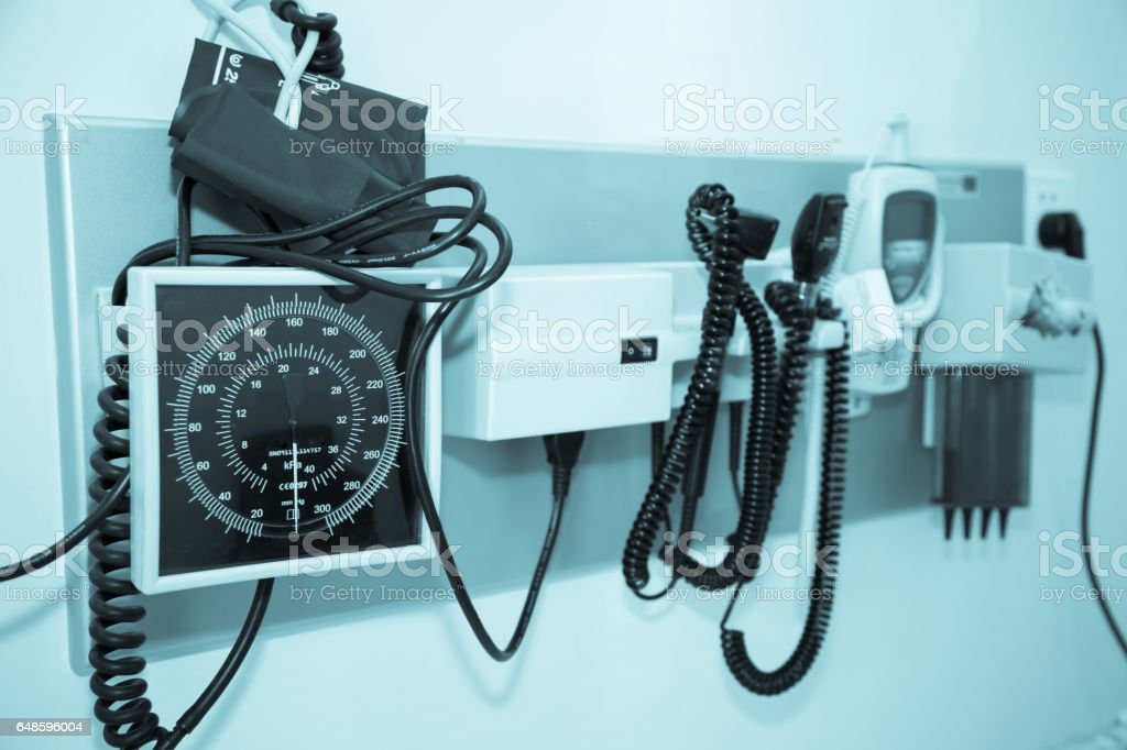 Standard doctor's office equipment mounted to a wall. stock photo