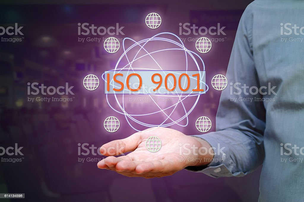 ISO 9001 standard for quality management of organizations with a stock photo