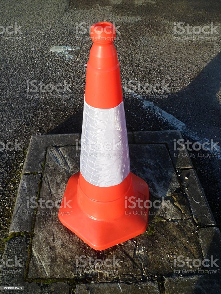 Standard orange traffic cone with reflective white band stock photo