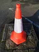 Standard orange traffic cone with reflective white band