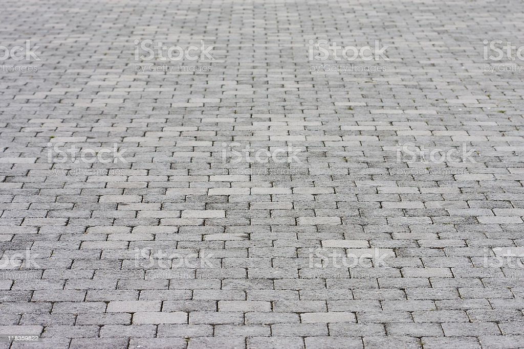 Standard pavement made up of rows of grey bricks royalty-free stock photo